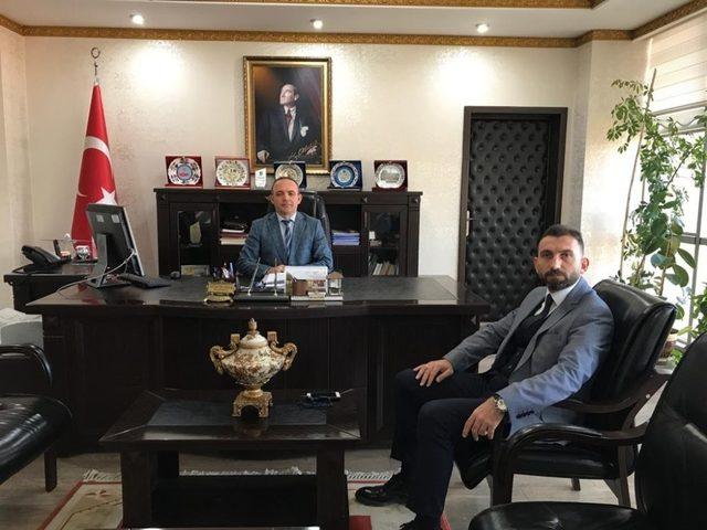 Burhaniye Meslek Yüksekokulu yeni müdüründen Kaymakam Öner'e ziyaret