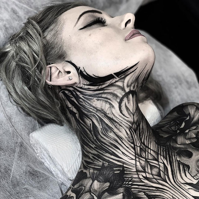 neck-tattoo-designs-58-5cf78ae041697__700