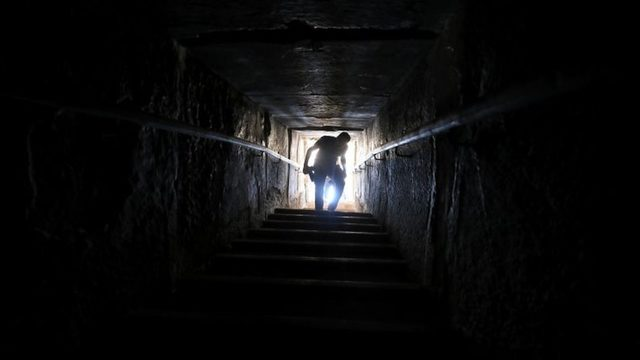 A man walks out of a passage from inside the Bent Pyramid. Photo: 13 July 2019