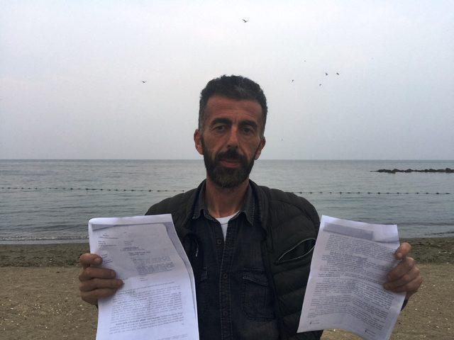 Bursa'da bacakları bağlanarak denize atılan köpek ölüsü, karaya vurdu